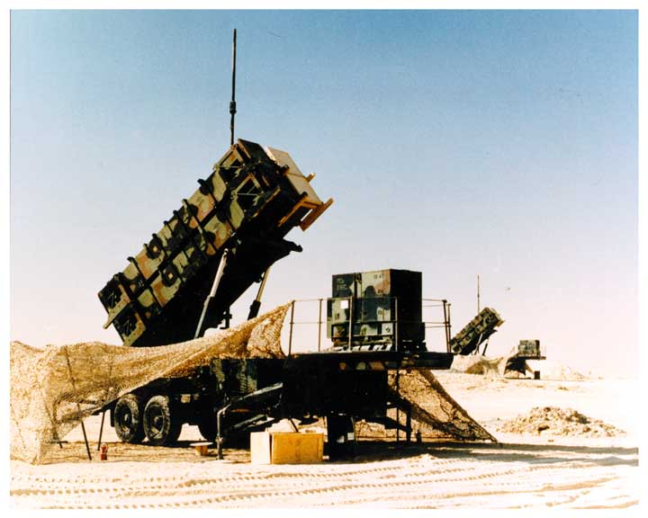 Photo of 2 PATRIOT missile systems in desert.