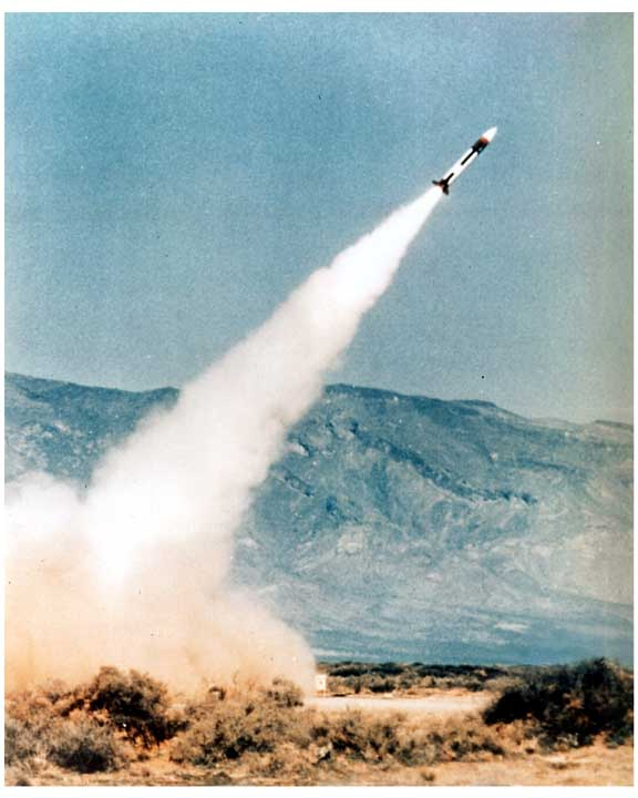Photo of PATRIOT missile captured in flight, streaming skyward.