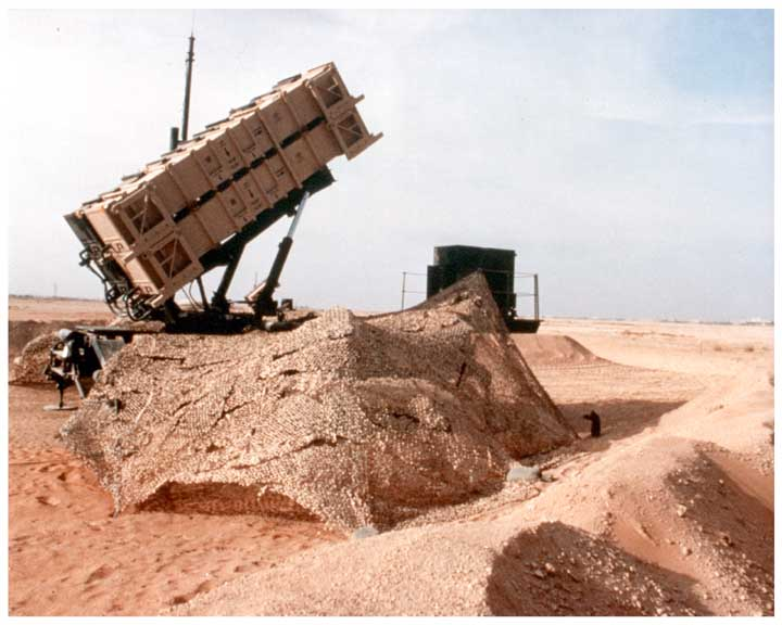 Photo of PATRIOT missile system launcher in desert firing position.