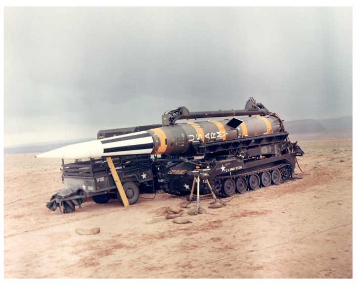 Photo of Pershing missile on its side on track mounted launcher.