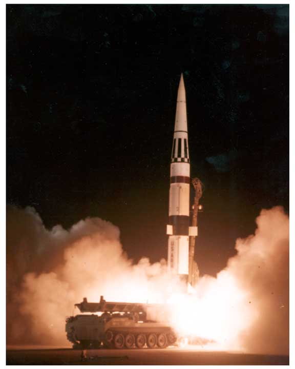 Photo of Pershing missile being launched from a track mounted launcher.